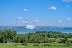 Berezovsky thermal power station on the shore of the reservoir, in the summer. Beryozovskaya thermal power station GRES is located in the city Sharypovo Stock Photography