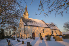 Berg Church in winter garb and sunset Stock Photography