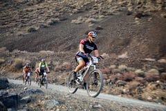 berg för affärsföretagcykelkonkurrens Royaltyfri Bild