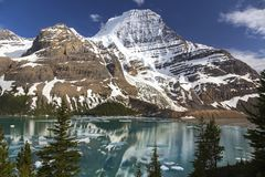 Berg Lake and Mount Robson. Snowy Robson Mountain Top and Berg Lake Landscape in Rocky Mountains British Columbia Canada Stock Photo