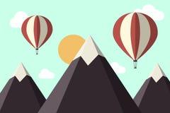Berg och ballonger för varm luft Arkivbild