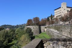 Bergamo. Is a city in Lombardy, Italy. It is situated about 40 km (25 mi) northeast of Milan and 30 km (19 mi) from the lakes Como and Iseo. The foothills of stock images