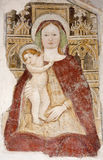 Bergamo -  Holy Mary with the child from facade of church Michele al pozzo bianco. Fresco of main nave is from year 1440 on January 26, 2013 in Bergamo, Italy Royalty Free Stock Images