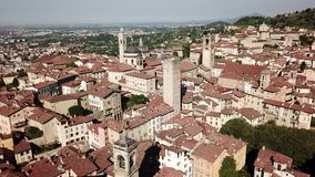 Bergamo, Italy. Amazing drone aerial view of the old town. Landscape at the city center and its historical buildings. Summer time stock footage
