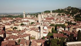Bergamo, Italy. Amazing drone aerial view of the old town. Landscape at the city center and its historical buildings. Summer time stock video footage