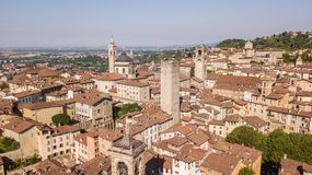 Bergamo, Italy. Amazing drone aerial view of the old town. Landscape at the city center, its historical buildings and the towers royalty free stock images