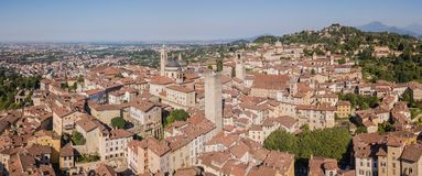 Bergamo, Italy. Amazing drone aerial view of the old town. Landscape at the city center, its historical buildings and the towers royalty free stock photography