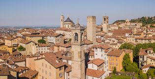 Bergamo, Italy. Amazing drone aerial view of the old town. Landscape at the city center, its historical buildings and the towers royalty free stock image