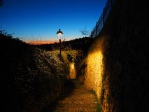 Bergamo, Italy. The ancient stone stairs that lead from the low city to the old one during evening. And spring time Stock Images
