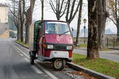 Traditional Italian three wheel car Piaggio Ape staying parked on the street Stock Photo