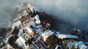 Bergamo, Italy. Drone aerial view of an amazing landscape of the fog rises from the plains and covers the hill of San Vigilio. Winter time stock video