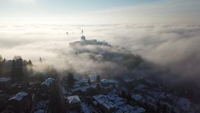 Bergamo, Italy. Drone aerial view of an amazing landscape of the fog rises from the plains and covers the old town. Winter time stock video