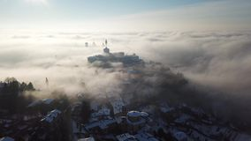 Bergamo, Italy. Drone aerial view of an amazing landscape of the fog rises from the plains and covers the old town. Winter time stock video footage
