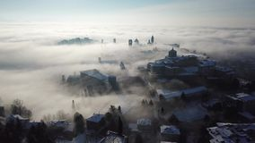 Bergamo, Italy. Drone aerial view of an amazing landscape of the fog rises from the plains and covers the old town. Winter time stock footage
