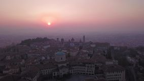Bergamo. Italy. Drone aerial view of a morning landscape at the old town during fall season stock footage
