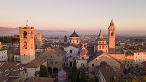 Bergamo, Italy. Drone aerial view of the Old city. Landscape on the city center and the historical buildings during the sunset Stock Photography