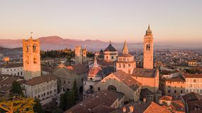 Bergamo, Italy. Drone aerial view of the Old city. Landscape on the city center and the historical buildings during the sunset Stock Image