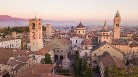 Bergamo, Italy. Drone aerial view of the Old city. Landscape on the city center and the historical buildings during the sunset Stock Photos