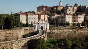 Bergamo, Italy. Drone aerial view of the old gate San Giacomo and historical building. The Old town stock video footage