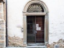 Door of Monastero San Benedetto in Bergamo city. BERGAMO, ITALY - FEBRUARY 25, 2019: door of school in Monastero San Benedetto Monastery of the Benedictine Nuns royalty free stock images