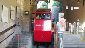 Bergamo, Italy. The red funicular at the lower station. It connects the new city with the old one stock video