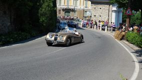 Bergamo, Italy. Historical Gran Prix. Parade of historic cars along the route of the Venetian walls that surround the old city. Original sound of historic cars stock video footage
