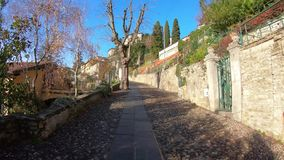Bergamo, Italy. Hyperlapse through the streets of the old city until the departure of the San Vigilio funicular stock footage