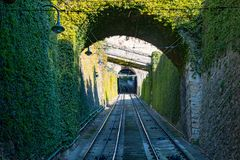 Bergamo, Italy Jan 25, 2019 - The red funicular in the old city of Bergamo is approaching the station at San Vigilio hill.  stock photography