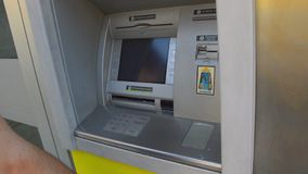 Bergamo, Italy - June 11, 2017: Man Using ATM Bank Machine To Get Cash. Automated teller machine is an electronic telecommunicatio. Ns device that enables the stock video footage
