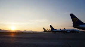 BERGAMO, ITALY - MAY 31, 2017: airplanes on the parking and beautiful sunrise on background at Orio al Serio International Airport Stock Photography