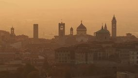 Bergamo, Italy. Morning landscape at the old town from Saint Vigilio hill during fall season stock video footage
