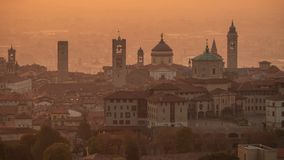 Bergamo, Italy. Morning landscape at the old town from Saint Vigilio hill during fall season stock photo