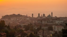 Bergamo, Italy. Morning landscape at the old town from Saint Vigilio hill during fall season stock photos