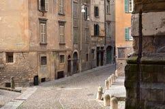 Bergamo, Italy-October 4,2014: Street in historic center with ancient buildings in Citta ALta of Bergamo, Italy. Royalty Free Stock Photography