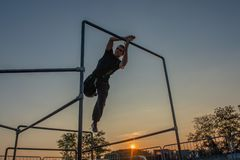 Overcome obstacles with jumps. Bergamo Italy October 12th 2018:Parkour `physical activity in running, climbing and jumping to overcome an obstacle royalty free stock images
