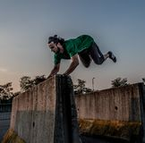 Overcome obstacles with jumps. Bergamo Italy October 12th 2018:Parkour `physical activity in running, climbing and jumping to overcome an obstacle royalty free stock image