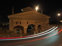 Bergamo, Italy. The old city. Landscape at the old gate San Giacomo door during the evening with trails of headlights royalty free stock images