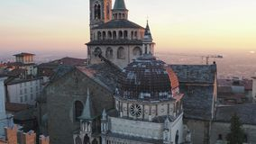 Bergamo, Italy. Aerial view of the Basilica of Santa Maria Maggiore and the chapel Colleoni during the sunset stock footage