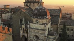 Bergamo, Italy. Aerial view of the Basilica of Santa Maria Maggiore and the chapel Colleoni during the sunset stock video