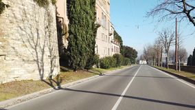 Bergamo, Italy. The Old town. Driver point of view. Driving along the avenues close to the Venetian walls stock footage