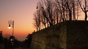 Bergamo, Italy. The old town. Fiery sunset along the ancient Venetian wall. Relaxing contest stock video footage