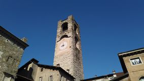 Bergamo, Italy. The old town. Landscape at the clock tower called Il Campanone. It is located in the main square of the upper town. Morning time stock video footage