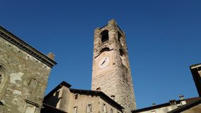 Bergamo, Italy. The old town. Landscape at the clock tower called Il Campanone. It is located in the main square of the upper town. Morning time stock footage