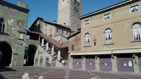 Bergamo, Italy. The Old town. Landscape at the clock tower Il Campanone and the monumental fountain stock video