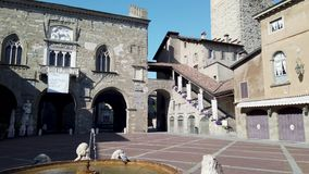 Bergamo, Italy. The Old town. Landscape at the clock tower Il Campanone and the monumental fountain. At the main square stock video footage