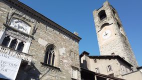 Bergamo, Italy. The old town. Landscape at the ancient Administration Headquarter and the clock tower stock footage