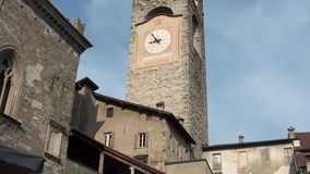 Bergamo - old city. Landscape on the the ancient Administration Headquarter called Palazzo della Ragione and the clock tower calle stock video footage
