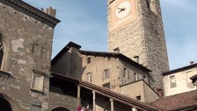 Bergamo - old city. Landscape on the the ancient Administration Headquarter called Palazzo della Ragione and the clock tower calle stock video