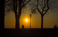 Bergamo old city. Lombardy, Italy. Silhouette of a person who admires the sunset towards the Po Valley. Fall season Stock Photography