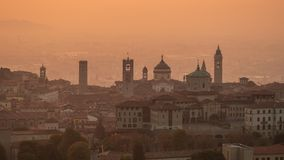Bergamo, Italy. Morning landscape at the old town from Saint Vigilio hill during fall season royalty free stock photography